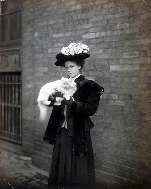 Woman standing outdoors with her cat, ca. 1905-1910. Jessie Tarbox Beals Photographs. PC60
