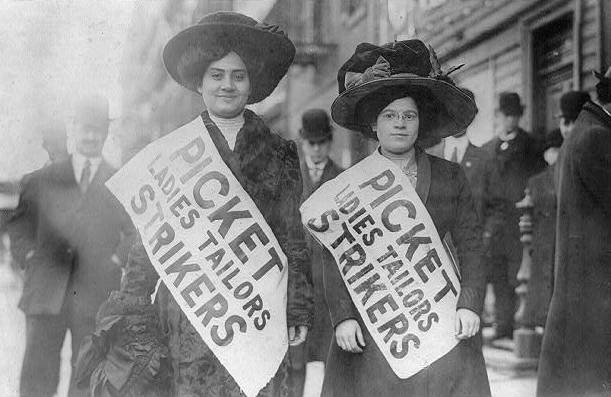 Black and white photo of two women with protest signs
