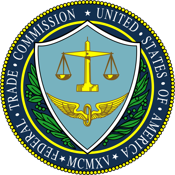U.S. Federal Trade Commission Seal. A winged flywheel and golden scales on a blue shield and framed by holly branches.