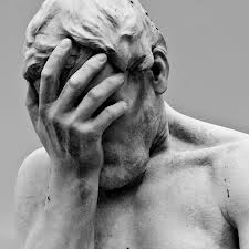 statue of man crying image