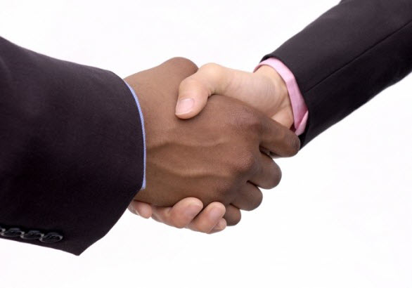 Multicultural handshake betwen man and woman