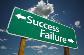 Picture of a roadsign with two arrows: one points toward Failure; one toward Success