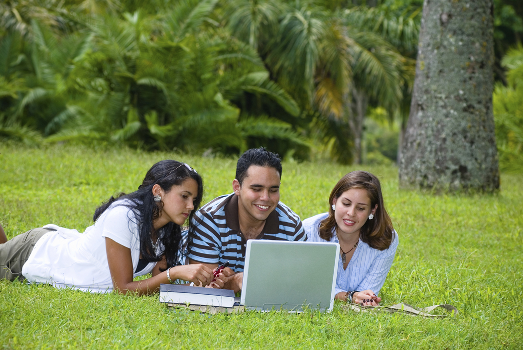 Young people using a laptop