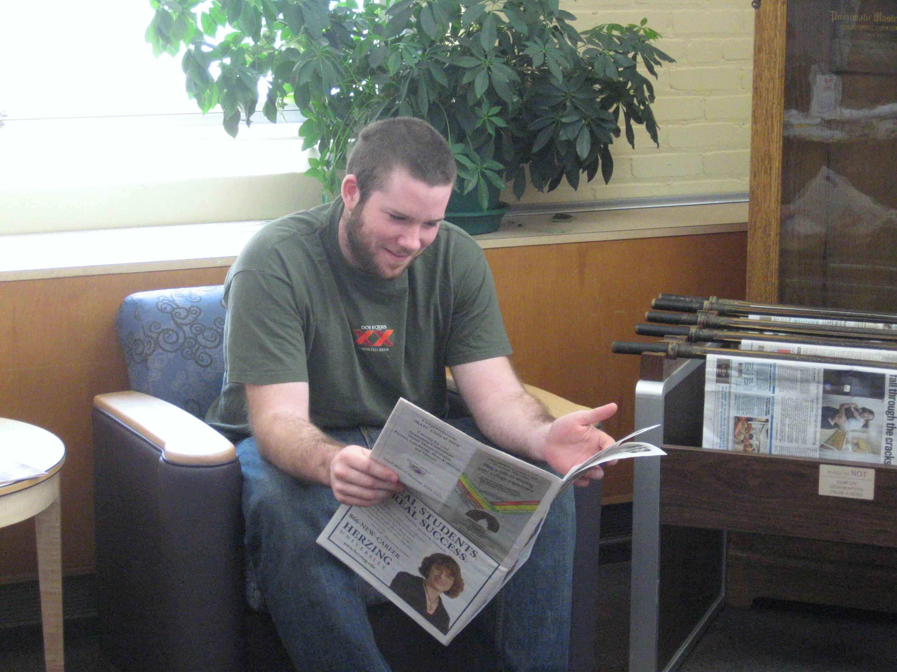Student reading a newspaper