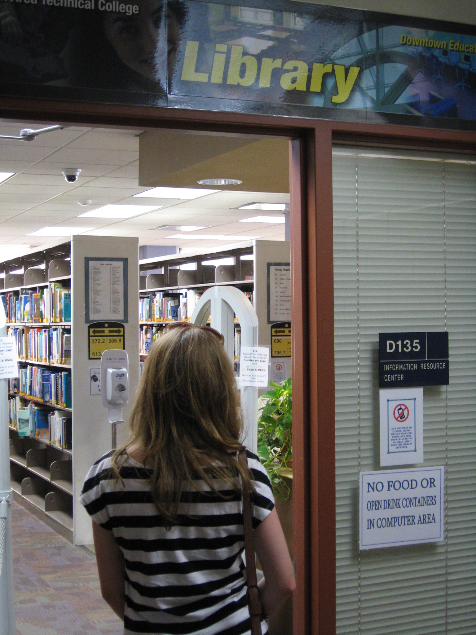 Student entering the Downtown library