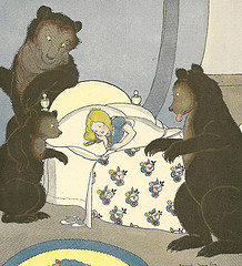 Color drawing of Goldilocks asleep with the three bears standing around her.