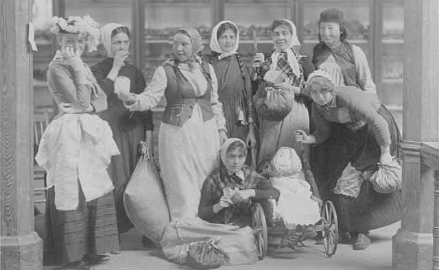 Women in clothing of early immigrants, 1895.
