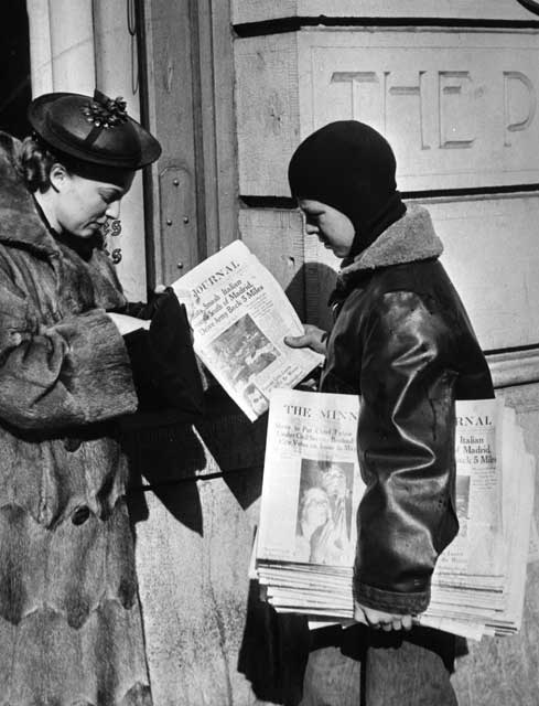 Newsboy distributing January 1937 Minneapolis Journal.