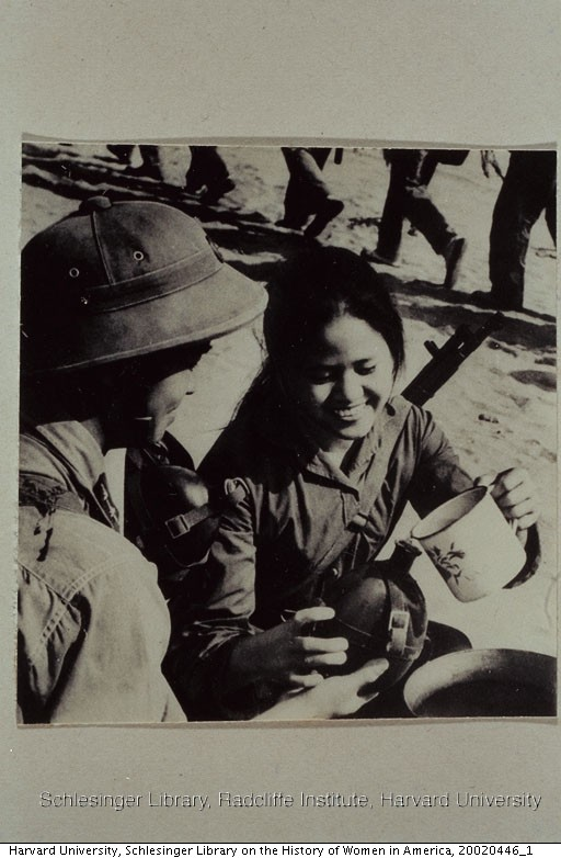 A Vietnamese woman soldier filling a canteen. From the Union Des Femmes Du Viet - Nam in Hanoi, 1972.