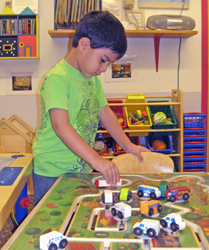 child playing in discovery room