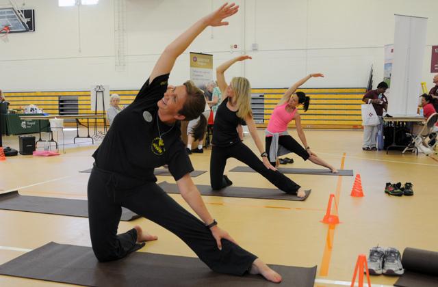 health image of people exercising on yoga mats