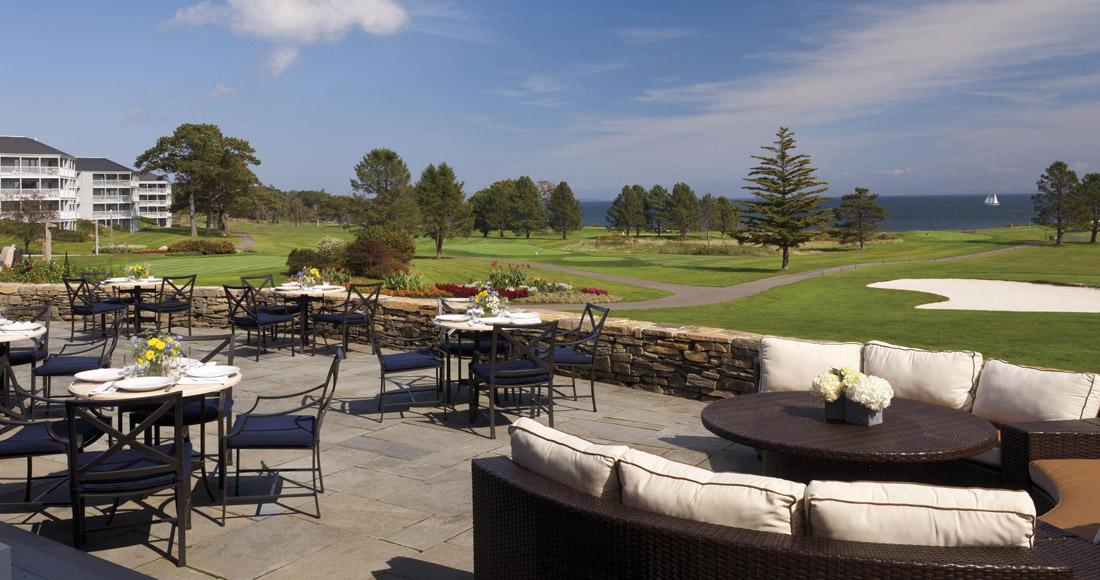 patio tables near a golf course
