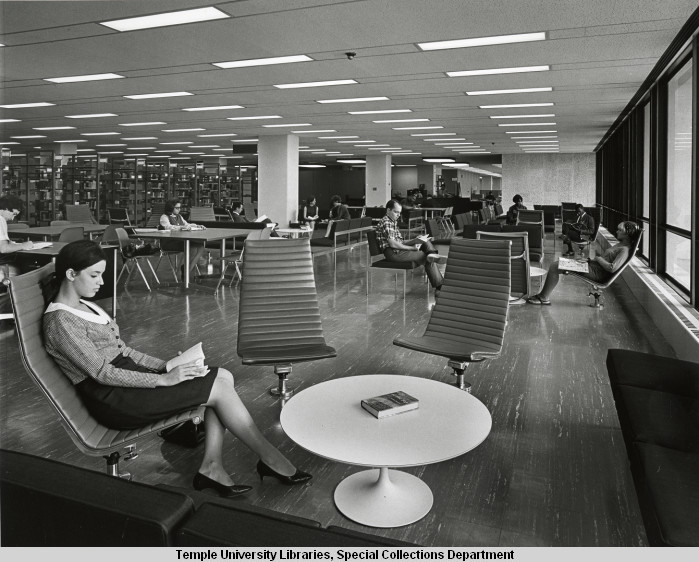 Photo of woman reading in Paley Library