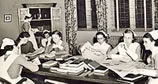 Nurses studying at a table
