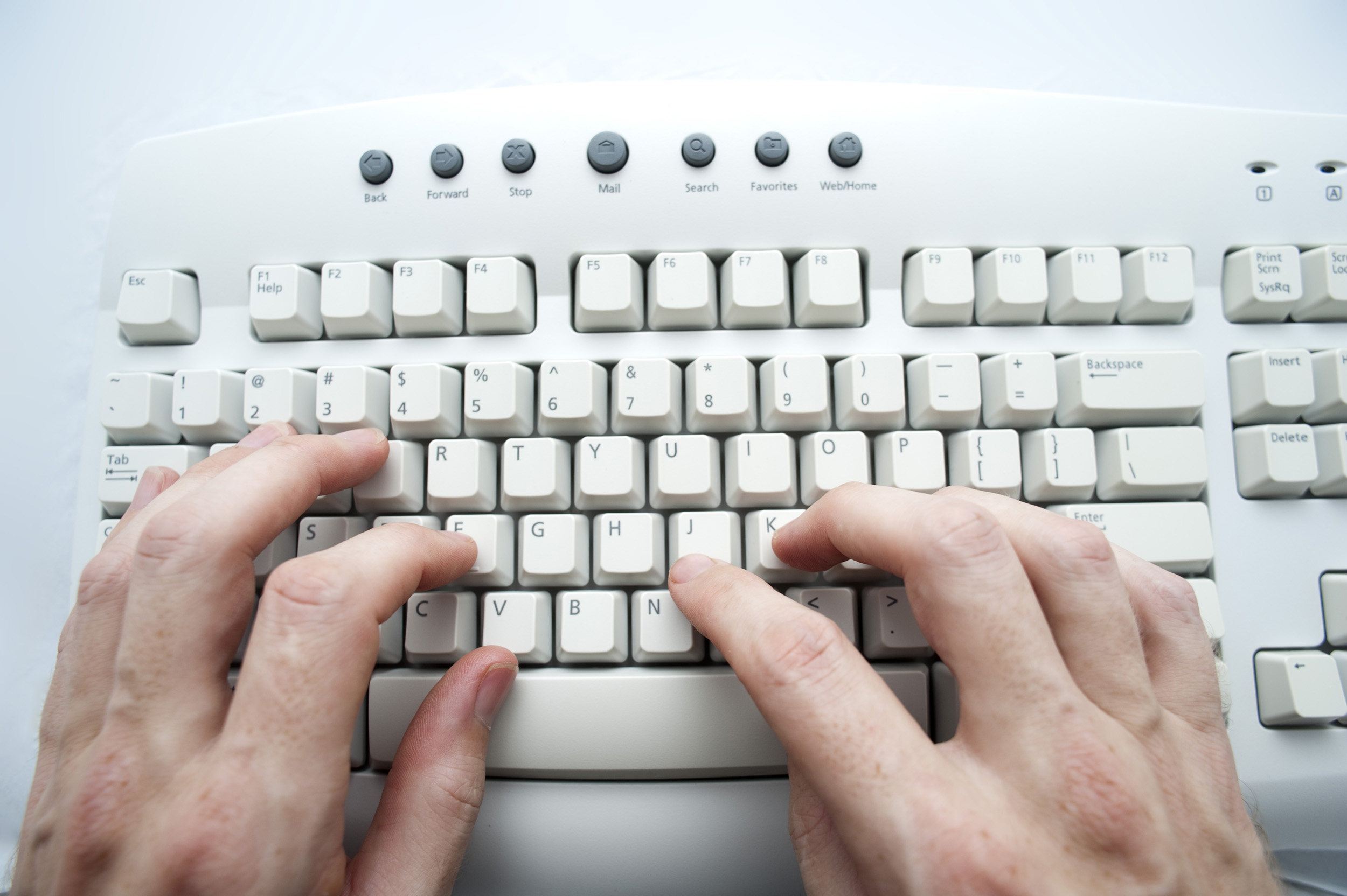 Fingers typing at a computer keyboard