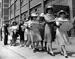 women in picket line with newspapers