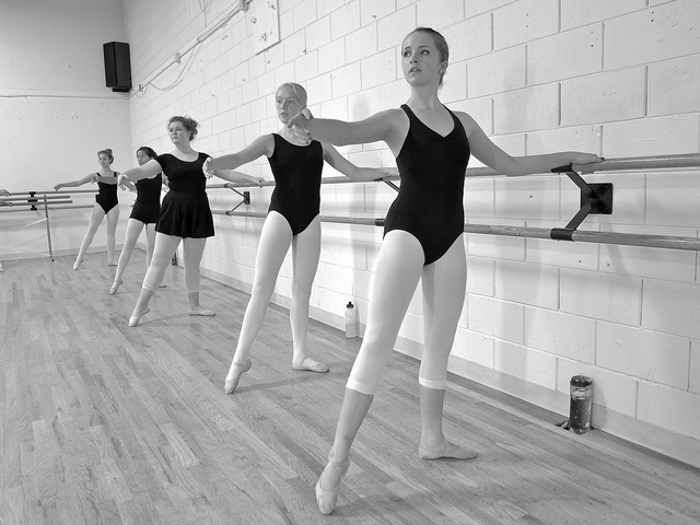 Ballet dancers doing turnout excerises at the barre
