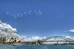 'Sorry' sky-writing in clear, blue sky over Sydney Habour and Sydney Opera House