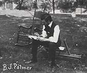 B.J. writing in a book