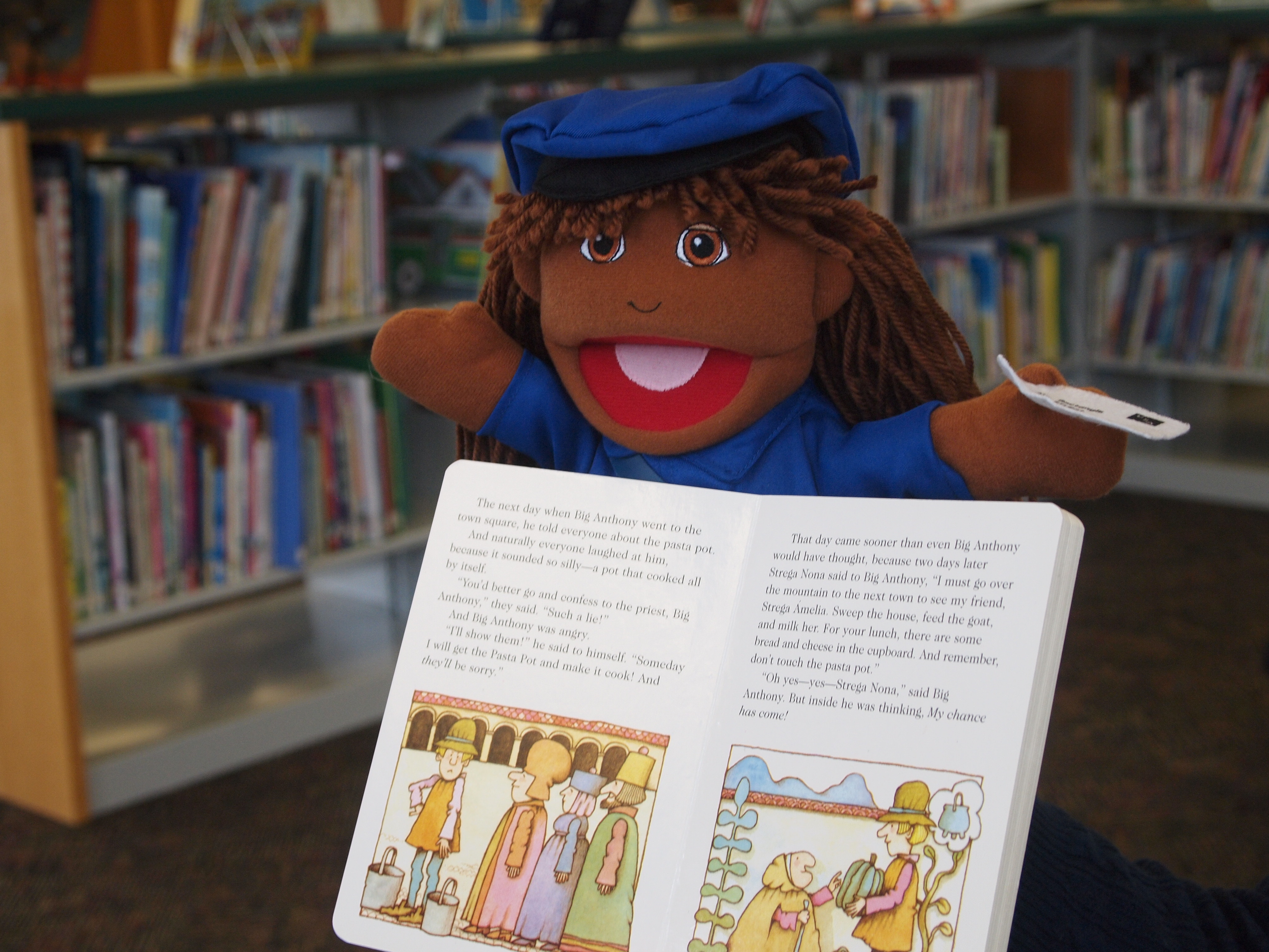 Puppet with book propped against it