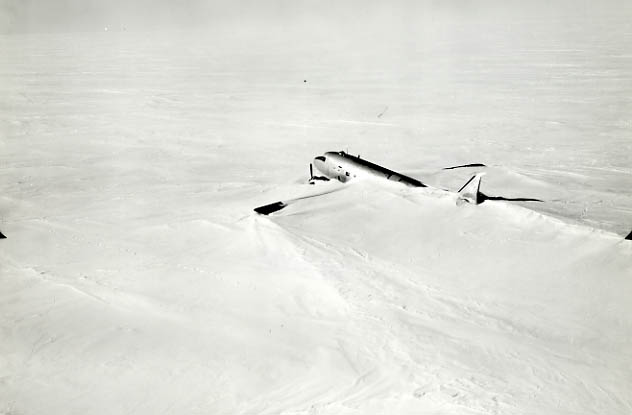 Photograph of DC4 airplane buried in snow in Antarctica 1948