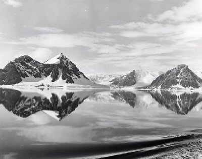 Photograph of snow covered mountains on the coast of Antarctica 1948