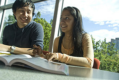 two students studying, link to Evaluating Information