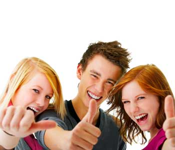 Two female students and one male student with thumbs up