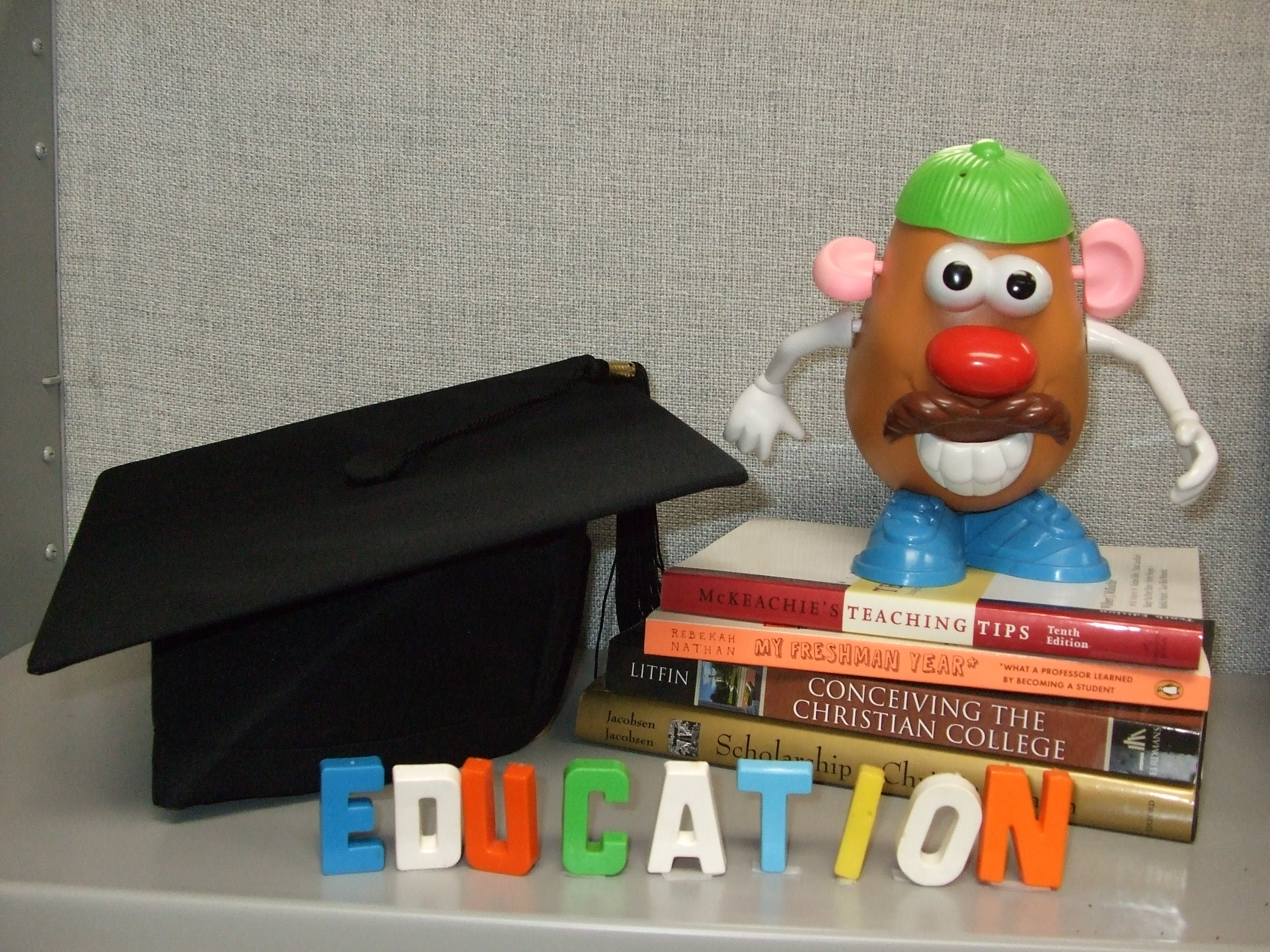 Mr. Potato Head on stack of books