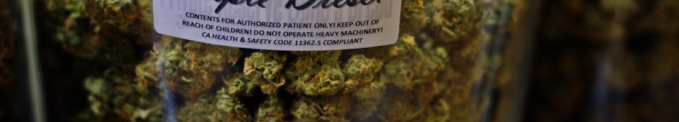 Jar of marijuana for sale in legal dispensary