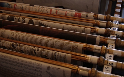 Newspapers on Newspaper sticks. Image courtesy of Christian Sheehy