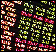 Stock price information on digital board.