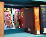 Image of student using library books