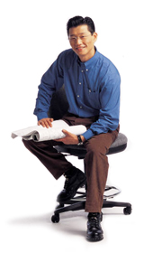 man sitting with plans