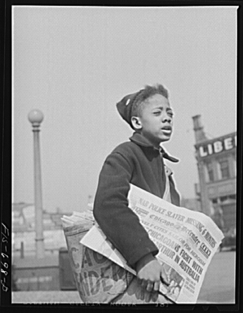 Newsboy selling The Chicago Defender in 1942