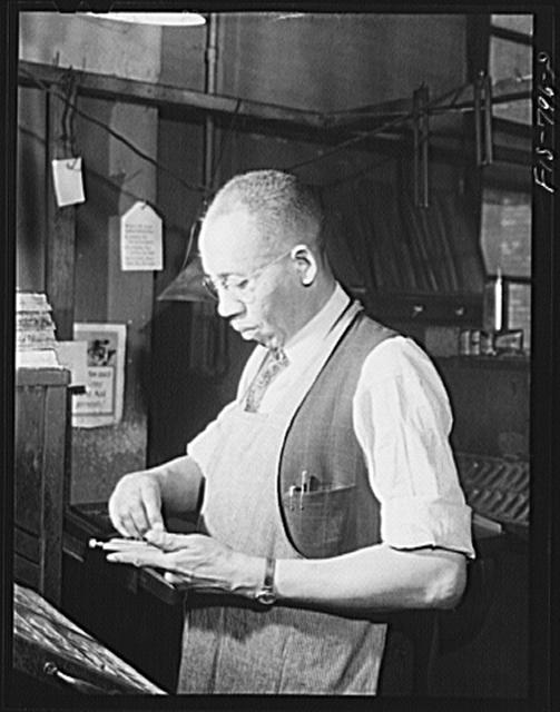 Image of A typesetter at The Chicago Defender in 1942