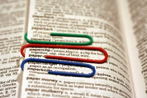 Three paperclips attached to a dictionary page