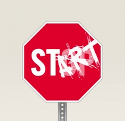Stop sign with the words art spray painted to say start