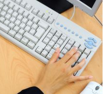 Hand on top of computer keyboard