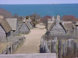 Photo of Plymouth Plantation buildings by the sea