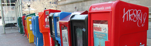 Photo of a row of newspaper vending machines.