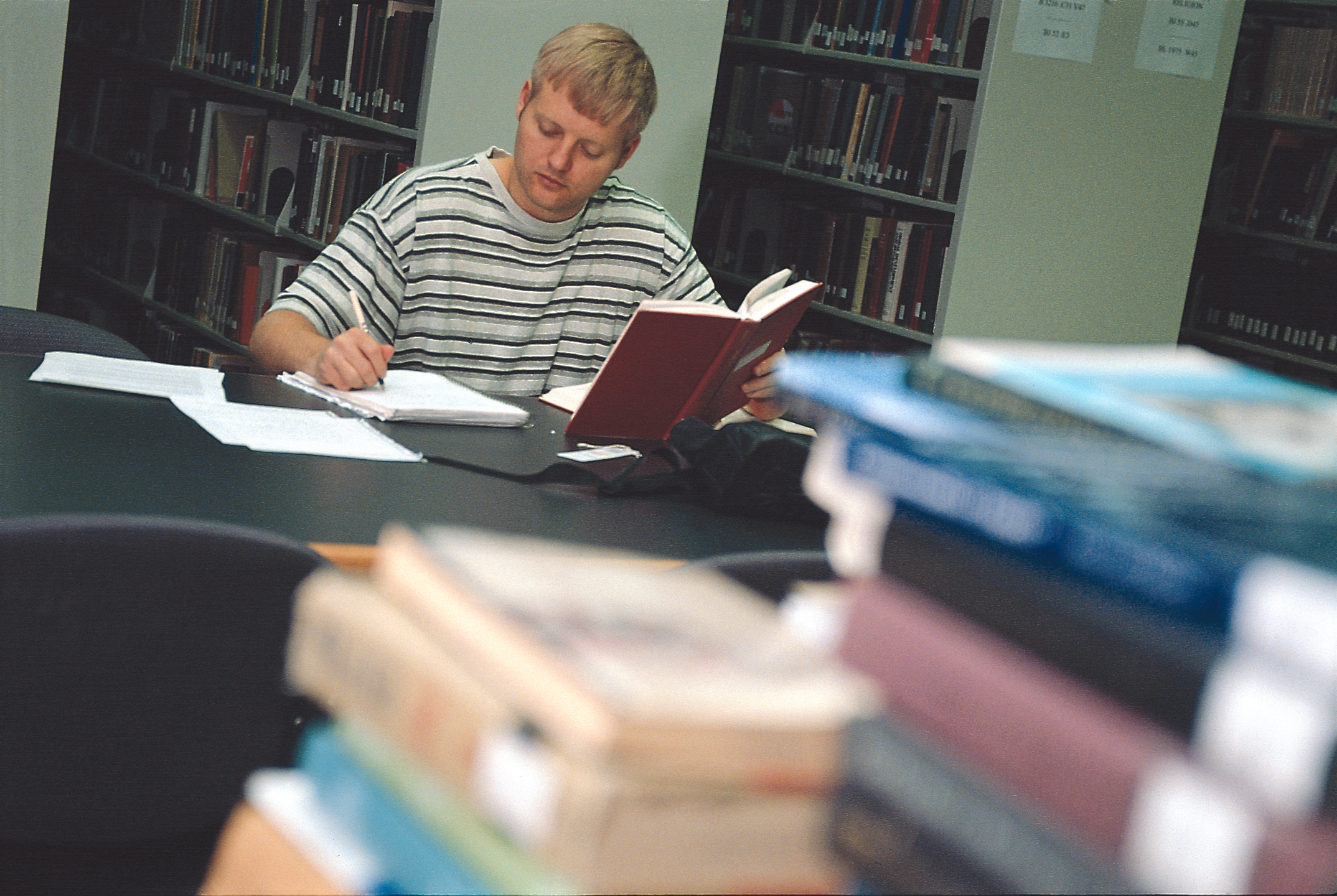 A man studying in library