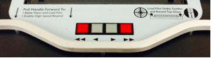 Red and gray motor controls at base of microform viewer's face