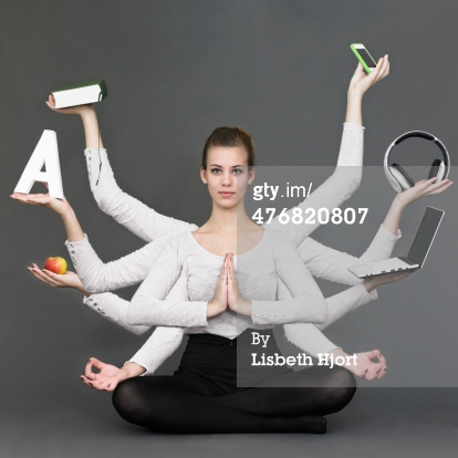 Woman in lotus position juggling tech tools