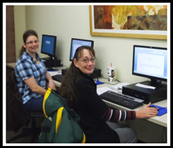 Two students working in West Library computer lab