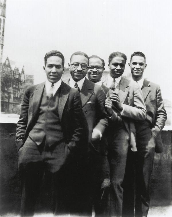 Image of five men, as cited in the figure below