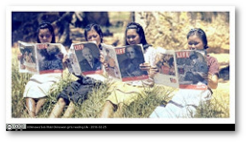 Okinawan girls reading Life magazine