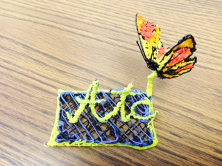 "3-D printed Butterfly on a stand that says ""ATC"""
