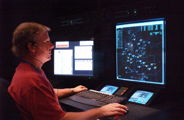 photo of an air traffic controller at a computer