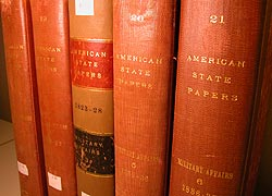 "Five physical volumes of ""American State Papers"" in a row."